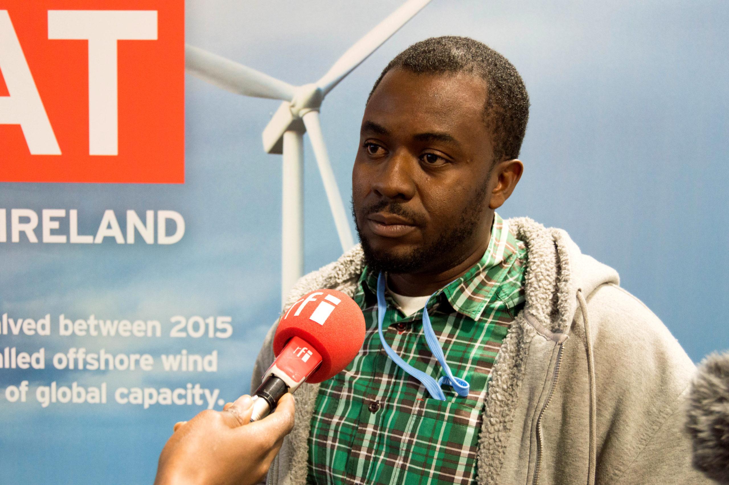 Climate campaigner Babawale Obayanju speaking at the UK's COP24 pavilion