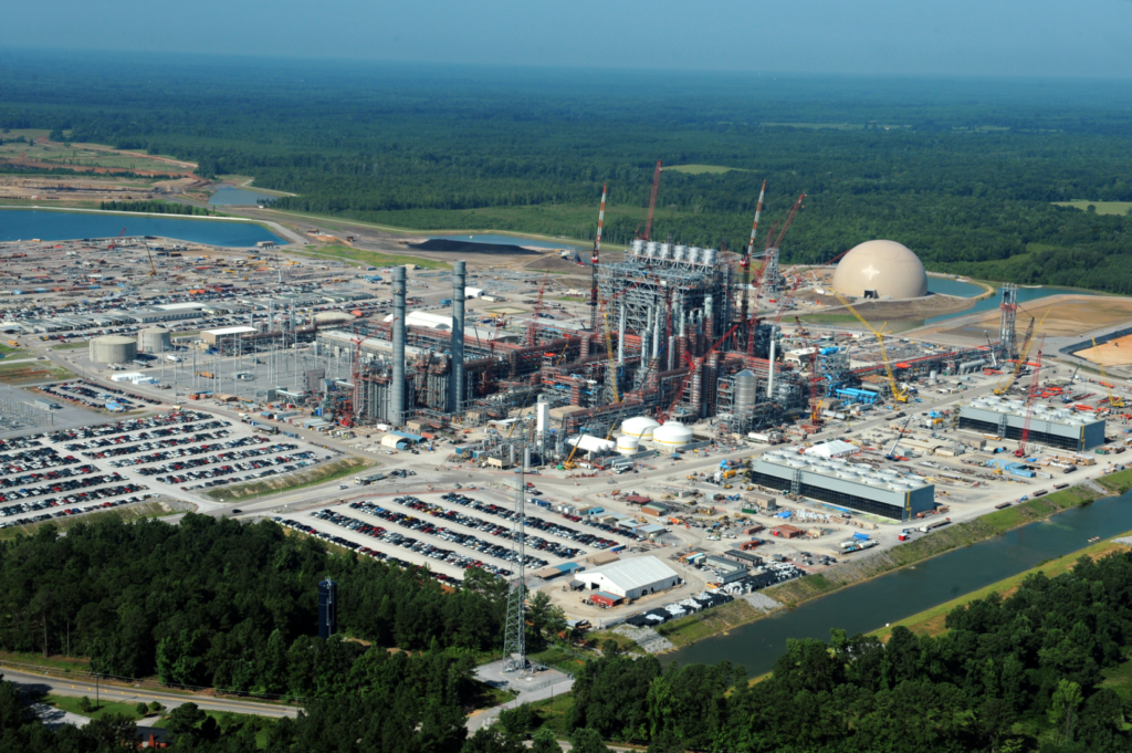 A massive coal gasification site under construction amid wooded areas