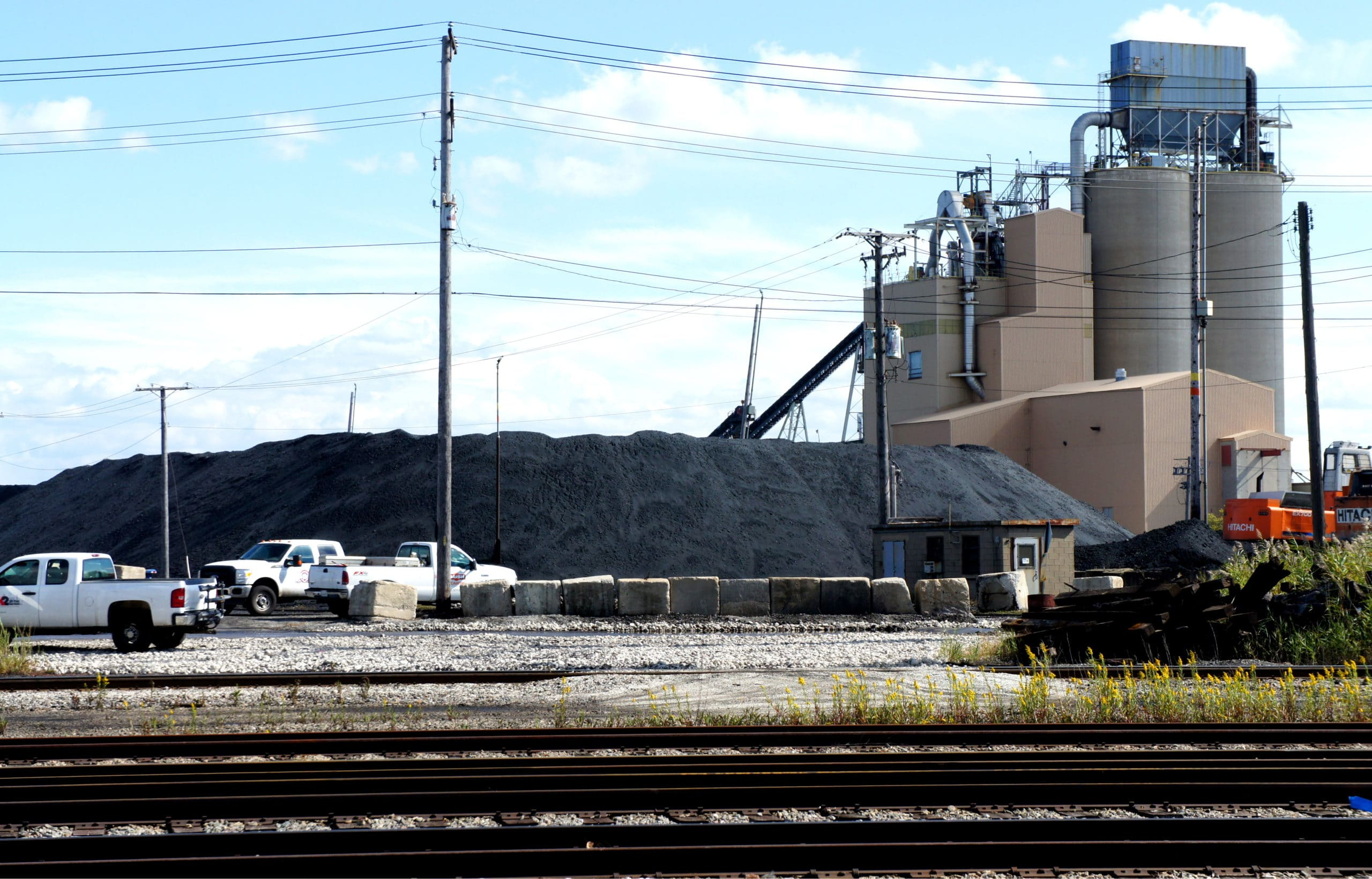 A view of the Koch brothers' pet coke piles from the property line of a resident in the Slag Valley neighborhood of Southeast Side Chicago.