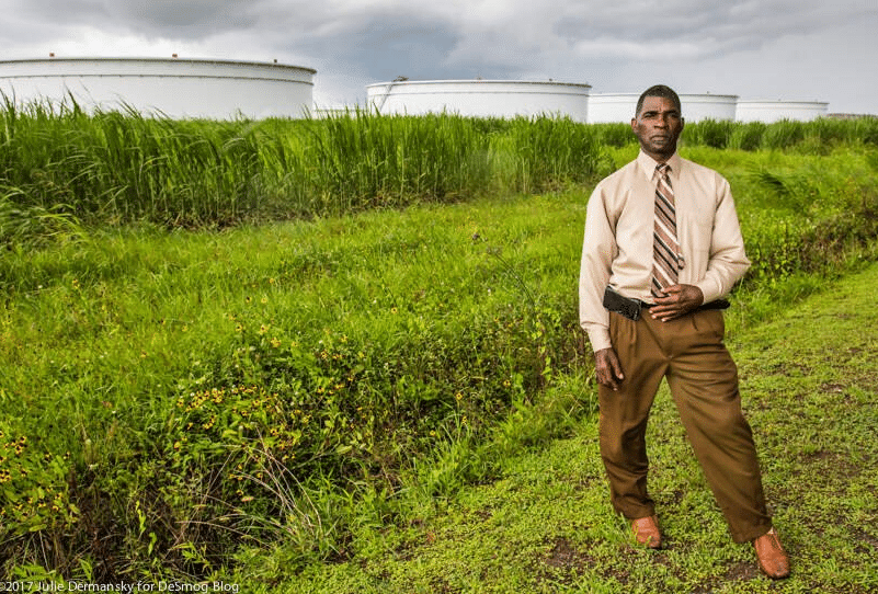 Pastor Harry Joseph near oil storage tanks in St. James, Louisiana, close to the Mount Triumph Baptist Church.