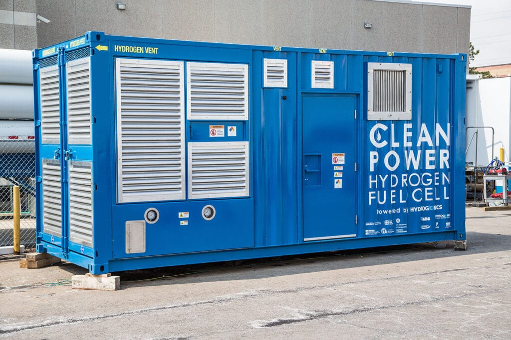Large blue rectangular container with the words 'clean power hydrogen fuel cell' in white text on it