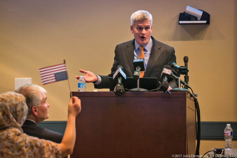 Sen. Cassidy at the podium at one town hall meeting.