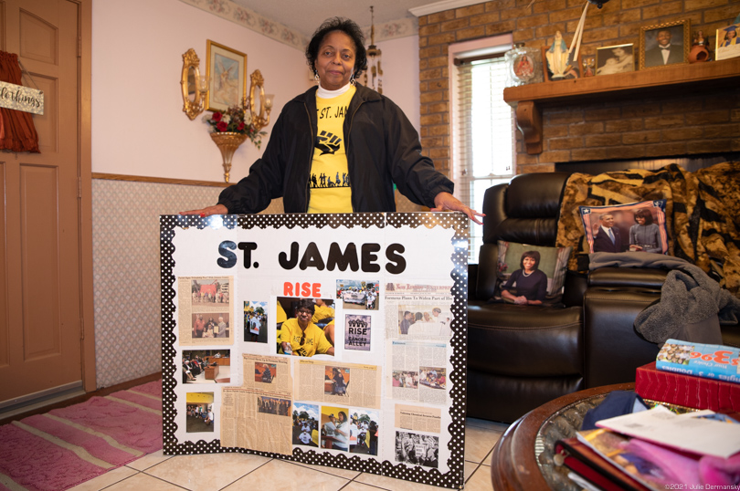 Sharon Lavigne with a display of photos from her ongoing fight against the encroaching petrochemical industry in St. James.