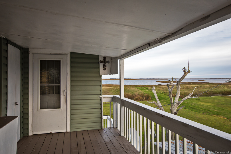 View of the water and marshes from a raised home on Isle de Jean Charles.
