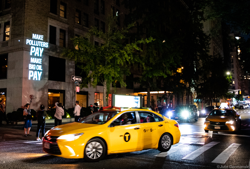 Anti-fossil fuel messages projected on the Gramercy Park Hotel in New York