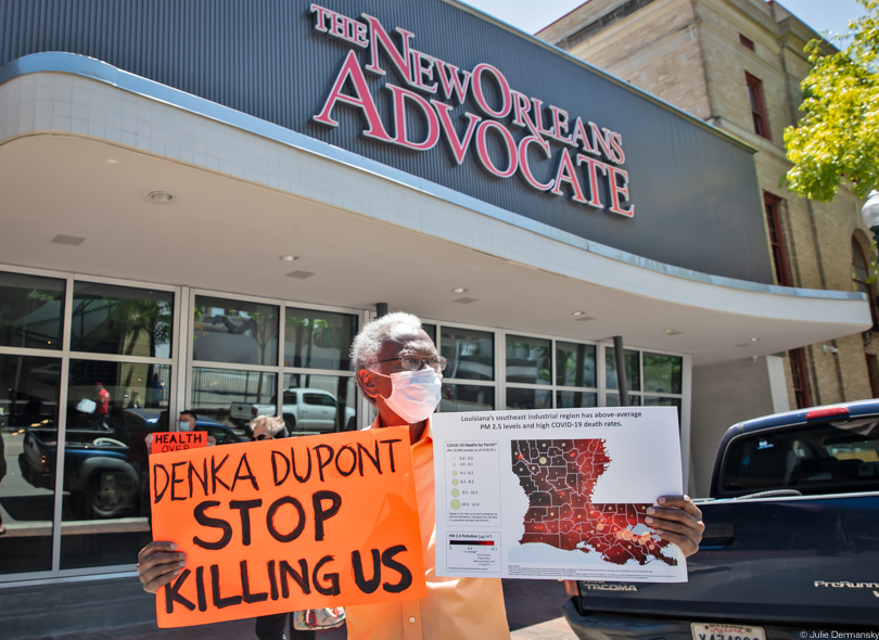 Robert Taylor holding a sign in protest outside The New Orleans Advocate office