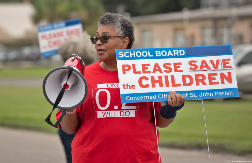 Tish Taylor, daughter of Robert Taylor, at a rally outside the Fifth Ward Elementary School