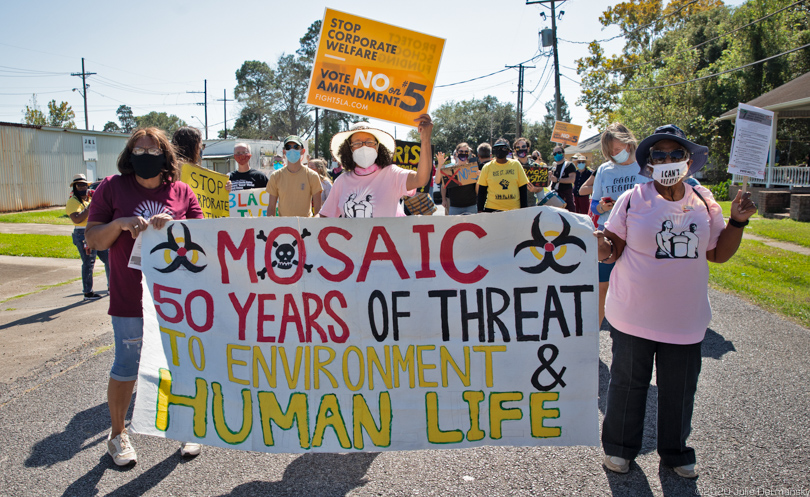 Cancer Alley residents and supporters march against pollution and Amendment 5 in Lutcher, Louisiana