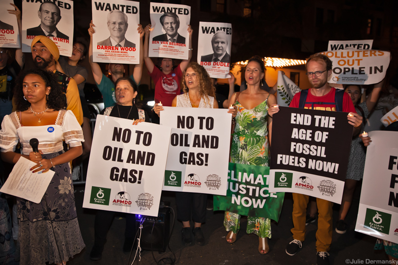 Climate justice activists protest outside the Oil and Gas Climate Initiative event