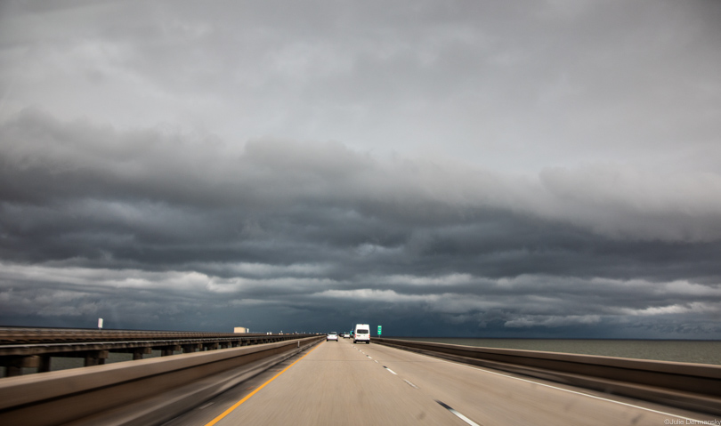 Spring rainclouds over the Causeway Bridge over Lake Pontchatrain.