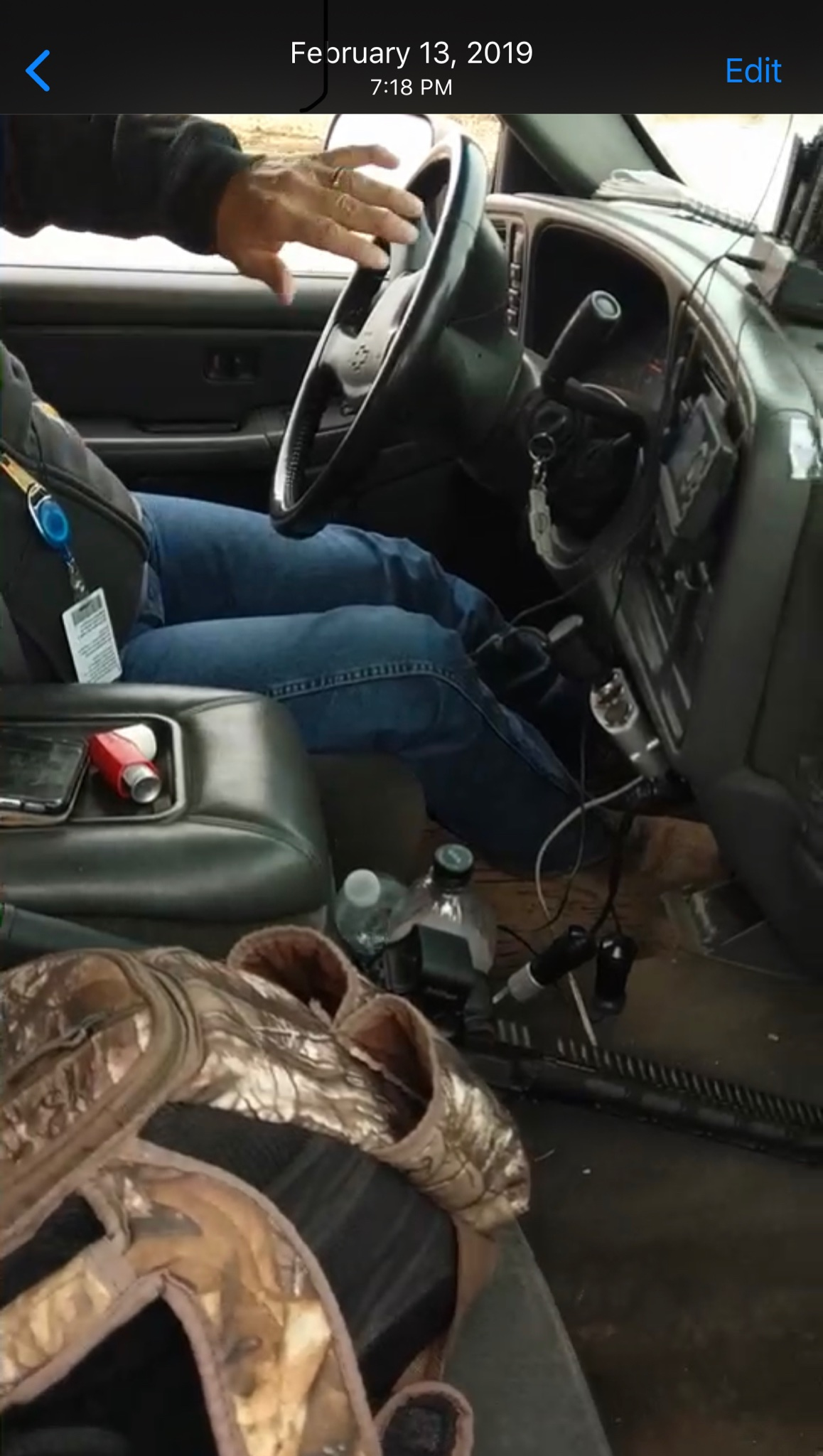 An oilfield security guard with a chambered 5.56 rifle in his company vehicle's front seat