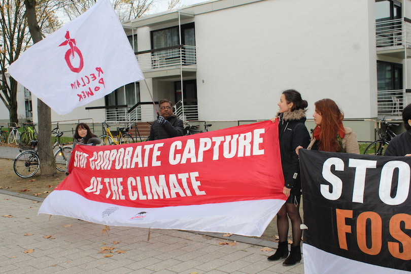 Activists protest corporate capture outside COP23 in Bonn, Germany