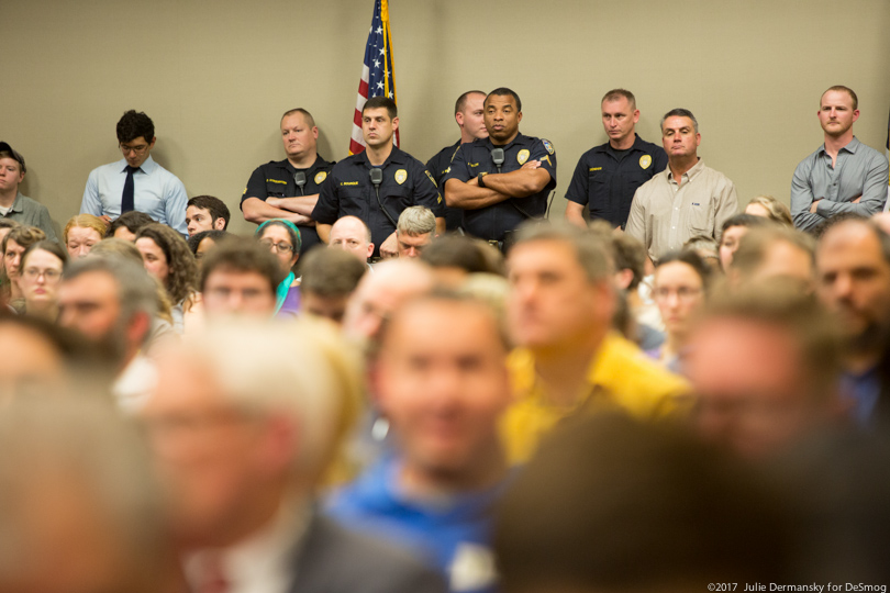 Law enforcement officers stand at the back of a packed room that turned out for a Bayou Bridge pipeline permit hearing
