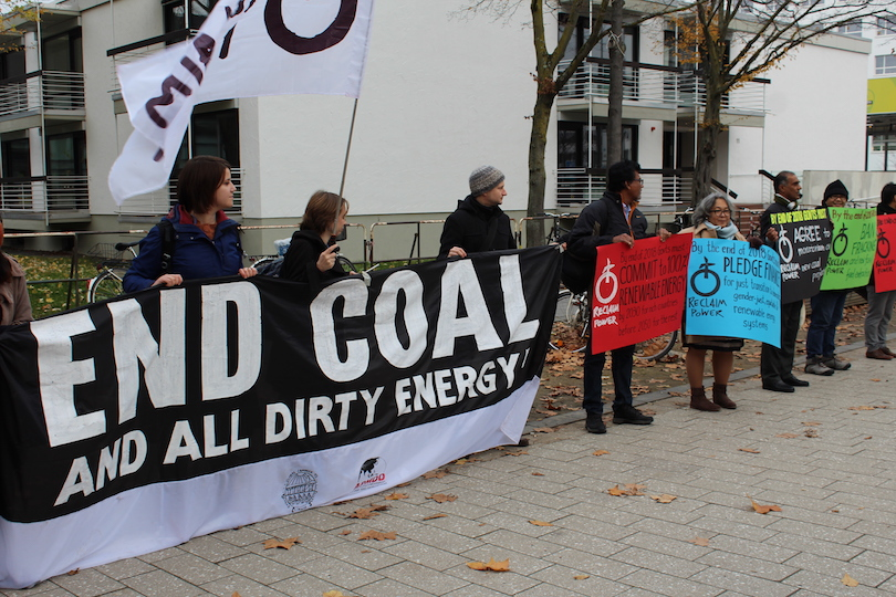 End coal sign and activists at UN climate talks in Bonn in 2017