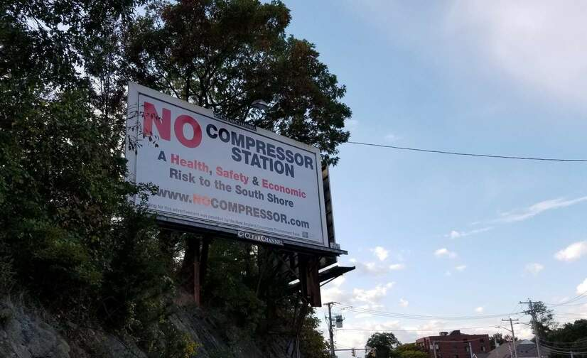 A billboard opposing Enbridge's proposed Weymouth gas compressor station.